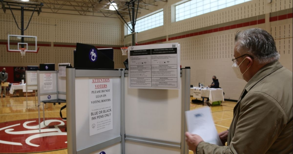 A voting booth is examined in Washington, D.C., on Nov. 3, 2020.