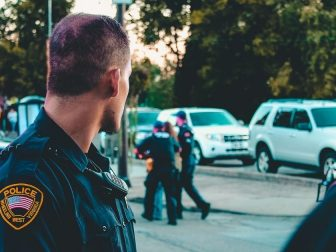 Police officer watching an arrest