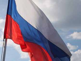 Russian flag flying on board boat on the Volga River