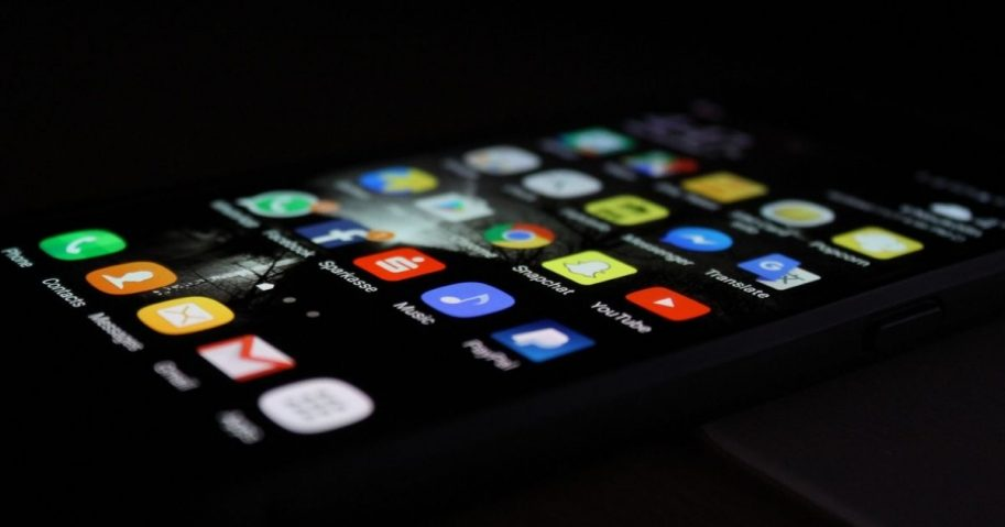 Phone in the dark displaying social media apps