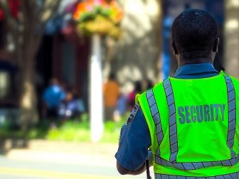 Security guard in neon green vest