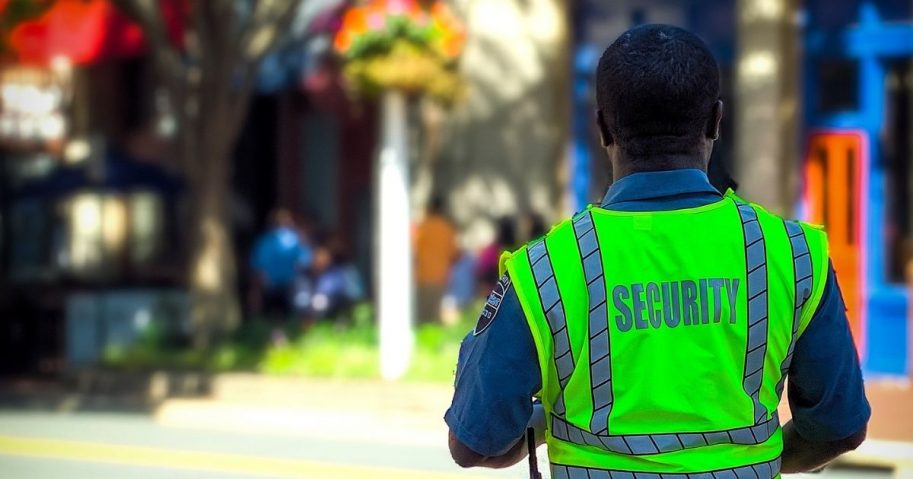 Security guard in neon green vest