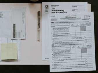 An open file folder with tax forms to be filled out.