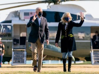 President Joe Biden and First Lady Jill Biden wave as they walk across the South Lawn of the White House after disembarking Marine One Sunday, March 21, 2021, concluding their trip to Camp David in Thurmont, Maryland. (Official White House Photo by Cameron Smith)