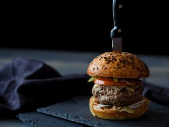 Homemade hamburger with a knife in it