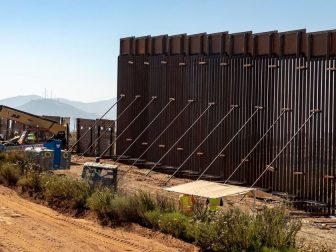 On 06-19-1019 Construction crews continue work on the new border wall on the boundary between the United States and Mexico near the Calexico Port of Entry.