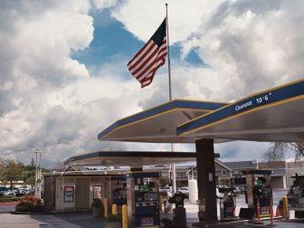 Flag, Gas Station, Mall, and Sky