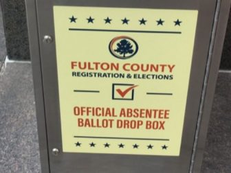 The above photo shows a Fulton County official absentee ballot drop box.