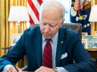 President Joe Biden signs a bill, S. 579, the ALS Disability Insurance Access Act of 2019 which retroactively gives access to Social Security disability benefits for individuals with ALS Tuesday, March 23, 2021, in the Oval Office of the White House. (Official White House Photo by Adam Schultz)