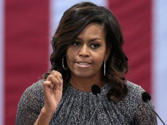 First Lady of the United States Michelle Obama speaking with supporters of former Secretary of State Hillary Clinton at a campaign rally at the Phoenix Convention Center in Phoenix, Arizona.