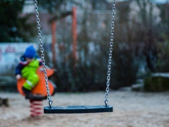 Empty swing at a playground