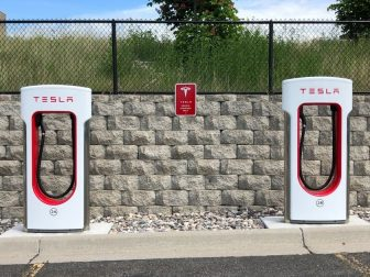 Tesla car charging stations in a parking lot