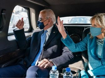 President Joe Biden and First Lady Dr. Jill Biden wave as they ride in the Presidential limousine Wednesday, Jan. 20, 2021, en route to Arlington National Cemetery in Arlington, Virginia. (Official White House Photo by Adam Schultz)