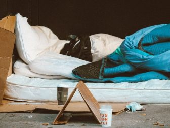 Mattress and sleeping bag on a sidewalk