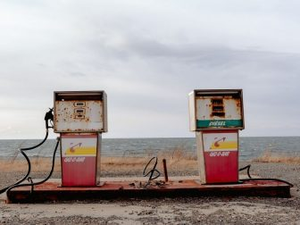 Old gas pumps on the beach