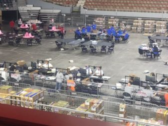 Workers conduct an audit of Maricopa County's 2020 general election in the Veterans Memorial Coliseum in Phoenix on Wednesday.
