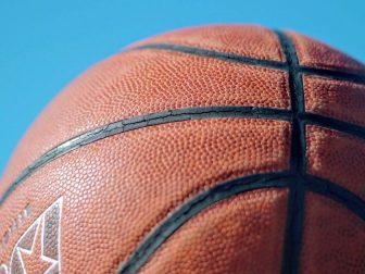 Brown basketball under a blue sky