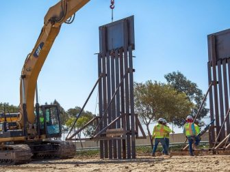 Construction workers putting up new wall at the border located at the Chula Vista Area of Responsibility, California, on June 19, 2018. Seen here is the placement of a new border wall panel. Photo by: Tim Tucciarone
