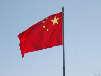 Chinese flag flying on a flag pole