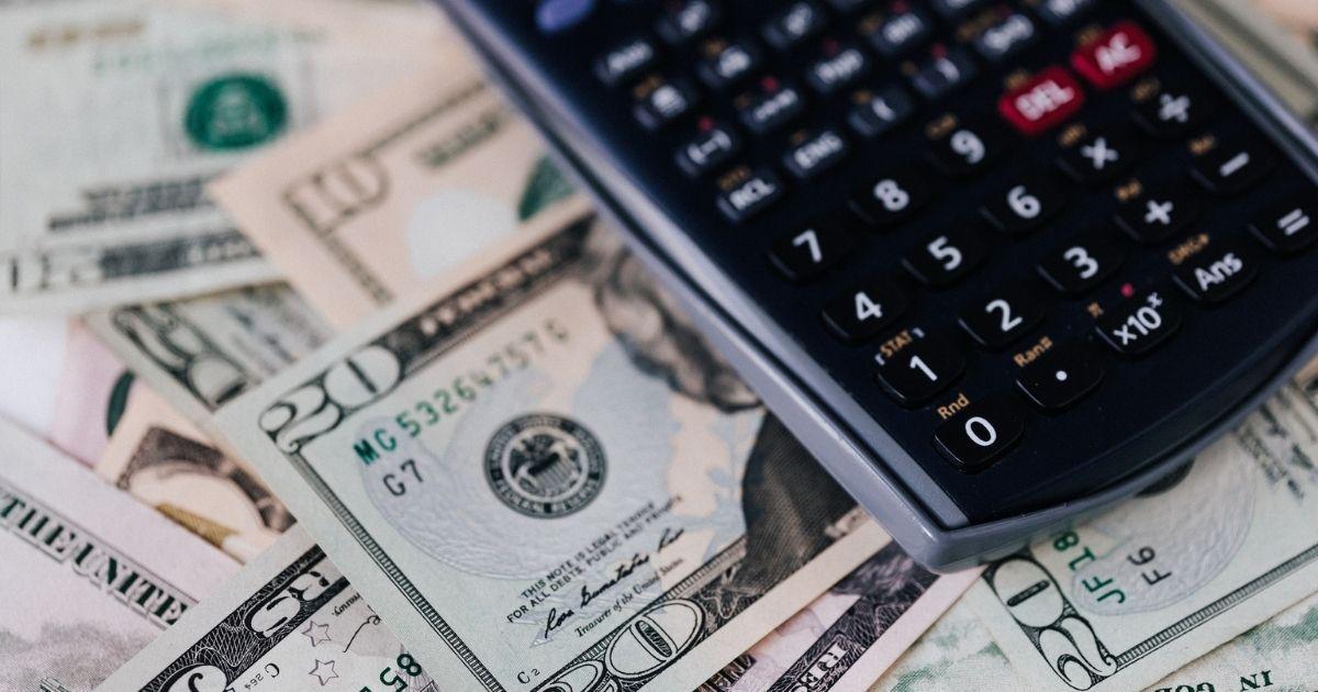 United States dollar bills and calculator