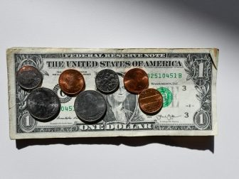 United States coins on a dollar bill