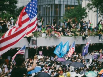 Tens of thousands of protesters waving US flags marched on Hong Kong's US Consulate