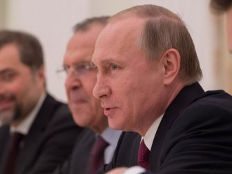 Russian President Vladimir Putin, accompanied by Russian Foreign Minister Sergey Lavrov, second from right, speaks during a meeting focused on Syria and Ukraine with U.S. Secretary of State John Kerry at the Kremlin in Moscow, Russia, on March 24, 2016.