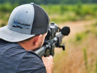 Man shooting at an outdoor gun range