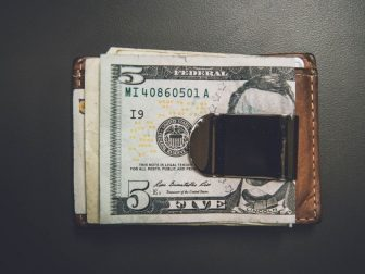 Wallet with cash clipped on to the outside