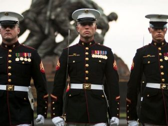 Three noncommissioned officers from Marine Barracks, Washington at 8th & I, perform during a Tuesday Sunset Parade at the Marine Corps War Memorial in Arlington, Va., July 30, 2013. There are seven companies with various sections that comprise Marine Barracks Washington, the U.S. Marine Band, the U.S. Marine Drum & Bugle Corps, Guard Company, Company A, Company B, Headquarters & Service Company, and Marine Corps Institute Company.