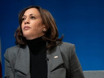 Vice President Kamala Harris listens during a virtual tour of the Community Vaccination Center at State Farm Stadium in Glendale, Arizona Monday, Feb. 8, 2021, in the South Court Auditorium in the Eisenhower Executive Office Building of the White House.