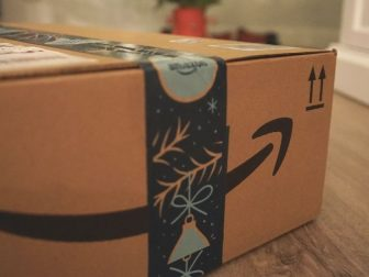 Brown and black amazon box under a Christmas tree
