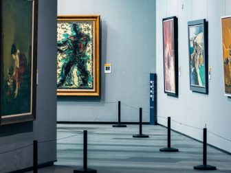 Empty art gallery with stations making a path