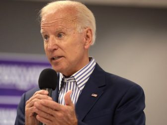 Former Vice President of the United States Joe Biden speaking with supporters at a town hall hosted by the Iowa Asian and Latino Coalition at Plumbers and Steamfitters Local 33 in Des Moines, Iowa.
