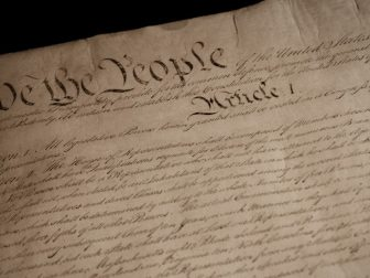 The Constitution of the United States of America is pictured.
