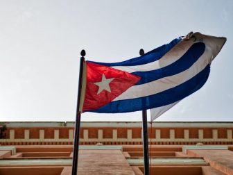 Cuban flag hanging from building window