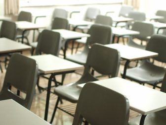 Empty student desks and chairs