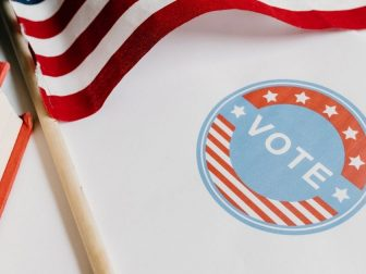 Vote sticker and American flag