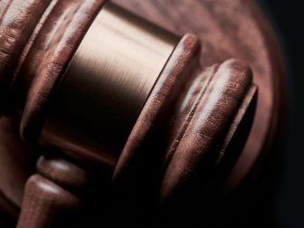 Gavel on black background with copy space