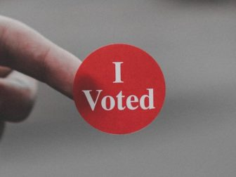 """The above stock photo shows a sticker that says, """"I Voted."""""""