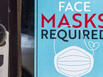"""Sign reading """"face masks required"""" at a Chicago, IL store"""
