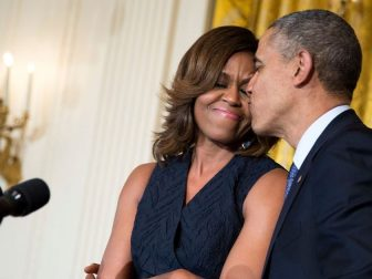President Barack Obama kisses First Lady Michelle Obama during her remarks at an Affordable Care Act reception in the East Room of the White House, May 1, 2014. (Official White House Photo by Pete Souza)