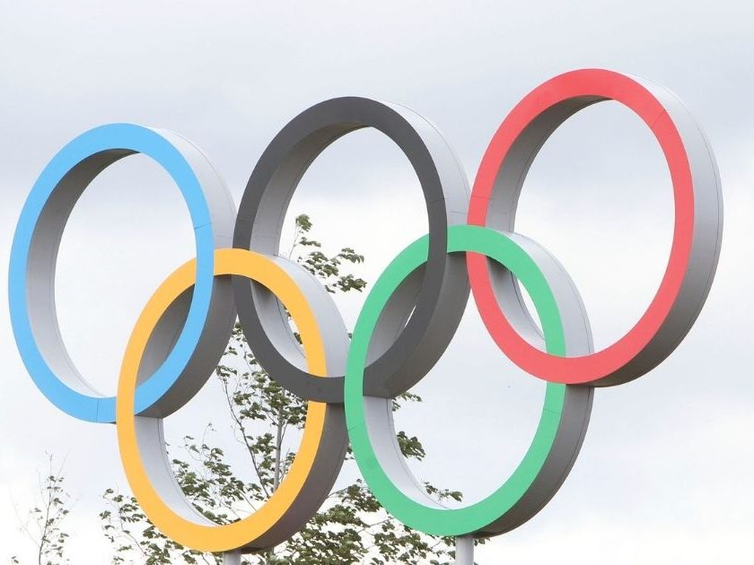 The above photo shows the Olympic rings above the Live Site East in front of the Velodrome.