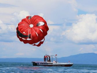 Red parasailor on a boat