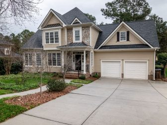 Front of beige house in suburbs