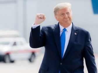 President Donald J. Trump gestures with a fist pump as he walks across the tarmac upon his arrival Thursday, Oct. 15, 2020, to Pitt-Greenville Airport in Greenville, S.C. (Official White House Photo by Shealah Craighead)