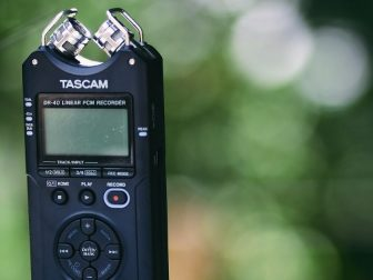 Tascam recording device with green background