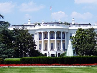 White House with red flowers in front
