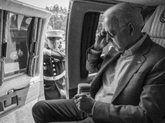 A U.S. Marine opens the door as President Joe Biden prepares to disembark Marine One, Saturday, July 3, 2021, at Antrim County Airport in Bellaire, Michigan.