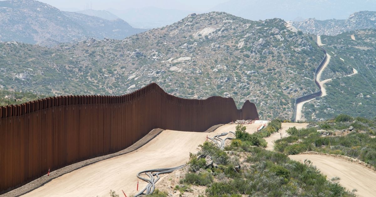 The Mexican-American border, with some construction still ongoing on the American side.